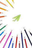 Kleurenpotloden met document vliegtuig 2 royalty-vrije stock afbeelding