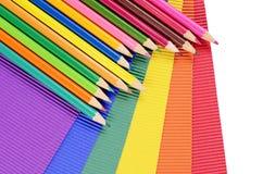 Kleurenpotloden op multi-colored document Royalty-vrije Stock Foto's