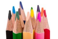 Kleurenpotloden op wit worden geïsoleerd dat Stock Foto