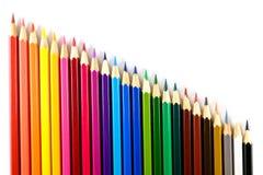 Kleurenpotlood op document achtergrond Royalty-vrije Stock Afbeelding