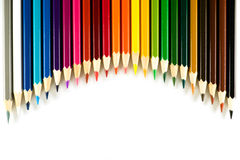 Kleurenpotlood op document achtergrond Stock Afbeelding