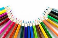 Kleurenpotlood op document achtergrond Stock Fotografie