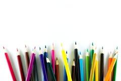 Kleurenpotlood op document achtergrond Royalty-vrije Stock Foto's
