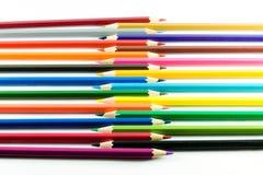 Kleurenpotlood op document achtergrond Stock Foto's