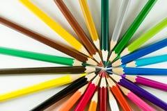 Kleurenpotlood op document achtergrond Stock Foto