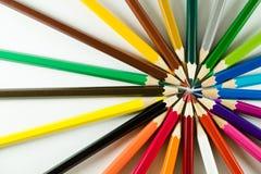 Kleurenpotlood op document achtergrond Stock Afbeeldingen