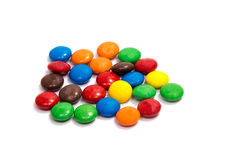 Kleurensuikergoed op een lijstachtergrond van kleur stock foto's