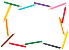 Kleurpotloden die als frame voor inscriptio worden geschikt Royalty-vrije Stock Afbeeldingen