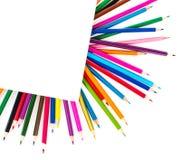 Kleurpotloden in het kader van een blad van document royalty-vrije stock afbeelding
