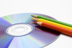 Kleurpotlood en CD Stock Afbeeldingen