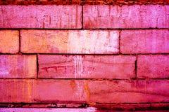 Kleurrijk bakstenen muurpatroon, geschilderde bakstenen als stedelijke textuur Stock Foto
