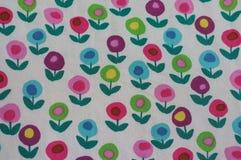 Kleurrijk bloemenpatroon op stof Stock Foto's