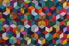 Kleurrijk die detail van dekbed van diamantstukken wordt genaaid stock foto