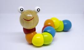 Kleurrijk houten rupsbandstuk speelgoed Stock Afbeelding