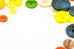 Kleurrijk knopenkader Stock Foto