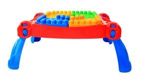 Kleurrijk lijststuk speelgoed voor kleine geïsoleerde jonge geitjes Stock Foto's