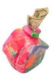 Kleurrijk moneyboxhuis met dollar Stock Foto
