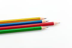 Kleurrijk Potlood in vuistmacht van geschreven woord op wit Royalty-vrije Stock Foto
