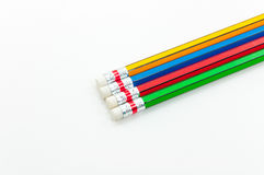 Kleurrijk Potlood in vuistmacht van geschreven woord op wit Stock Foto