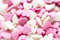 Kleurrijk suikergoed op abstract textuurpatroon als achtergrond Stock Fotografie