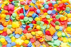 Kleurrijk suikergoed op abstract textuurpatroon als achtergrond Royalty-vrije Stock Afbeelding