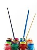 Kleurrijk van flessenplakkaatverf en penseel royalty-vrije stock fotografie