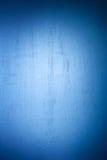 Kleurrijke abstracte vlotte textuur met met selectieve vlekken van verf Blauwe achtergrond met vignet en helder centrum stock afbeelding
