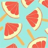 Kleurrijke achtergrond met plakken van grapefruit op een toverstokje Royalty-vrije Stock Foto