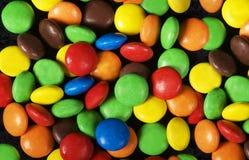 Kleurrijke achtergrond Suikergoed Multicoloured achtergrond Kleuren Kleurrijke snoepjes Zoete voedselachtergrond Woestijn Royalty-vrije Stock Afbeeldingen