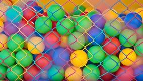 Kleurrijke bal in kooi royalty-vrije stock afbeeldingen