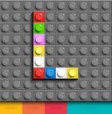 Kleurrijke brief L van de bouw van legobakstenen op grijze legoachtergrond Legobrief M royalty-vrije illustratie