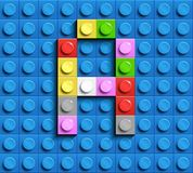 Kleurrijke brief A van de bouw van legobakstenen op blauwe legoachtergrond Legobrief M stock illustratie