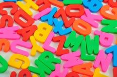 Kleurrijke brieven Stock Foto's