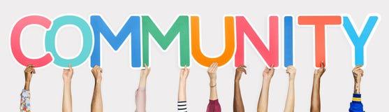 Kleurrijke brieven die de woordgemeenschap vormen royalty-vrije stock foto