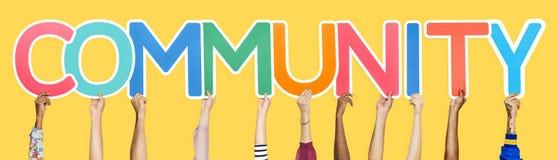 Kleurrijke brieven die de woordgemeenschap vormen stock fotografie