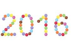 2016 in kleurrijke chocoladedragees Stock Afbeeldingen