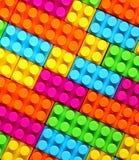 Kleurrijke de baksteenstuk speelgoed van Kinderenlego achtergrond stock afbeeldingen