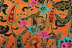 Kleurrijke de stoffenachtergrond van de batikdoek stock afbeelding