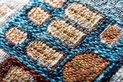 Kleurrijke de textuurmacro van het gobelintapijtwerk Stock Foto
