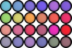 Kleurrijke die oogschaduw in zwarte dozen op wit worden geïsoleerd Stock Foto