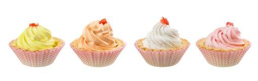 Kleurrijke die roomcakes op witte achtergrond worden geïsoleerd royalty-vrije stock fotografie