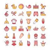 Kleurrijke die van babyspeelgoed en kleren pictogramreeks op een witte achtergrond wordt geïsoleerd royalty-vrije illustratie