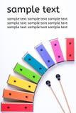 Kleurrijke die xylofoon op witte achtergrond wordt geïsoleerd Stock Foto's