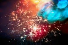 Kleurrijke donkere de hemelachtergrond van het Vakantievuurwerk ob met bokeh Royalty-vrije Stock Afbeeldingen