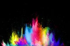 Kleurrijke explosie voor Gelukkig Holi-poeder Abstracte achtergrond van kleurendeeltjes uitbarsting of het bespatten stock foto's