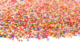 Kleurrijke Gekleurde suiker be*strooien-regenboog Stock Afbeelding