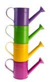 Kleurrijke gestapelde gieters Stock Fotografie