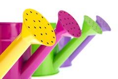 Kleurrijke gieters Stock Afbeelding