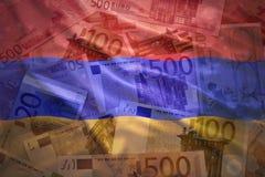 Kleurrijke golvende Armeense vlag op een euro achtergrond Royalty-vrije Stock Foto's