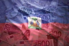 Kleurrijke golvende haitian vlag op een euro achtergrond Stock Foto